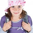 Cute schoolgirl with cap — Stock Photo