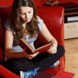 Teenage girl reading at home — Stock Photo #11555103