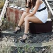 Young woman sitting on railroad — Stock Photo #11555202