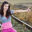 Stock Photo: Girl hitchhiking at railroad