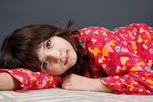 Cute girl in pyjamas — Stock Photo