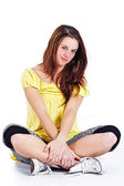 Girl sitting with crossed legs — Stock Photo