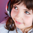 Cute girl with headset - Stock Photo
