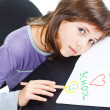 Cute schoolgirl resting on desk - Foto Stock