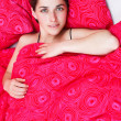 Young woman in bed — Stock Photo