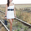 Young woman barefeet on rail — Stockfoto