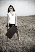Portrait of a young sexy woman with suitcase — Stock Photo