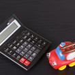 Toy car and calculator — Stock Photo #11671932