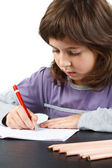 Cute little girl writing — Stock Photo