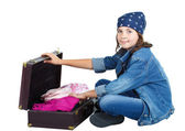 Cute girl sitting with open suitcase — Stock Photo