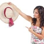 Beautiful woman showing a straw hat — Stock Photo #11943511