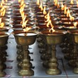Stock Photo: Candles burning in a Buddhist temple.
