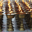 Candles burning in a Buddhist temple. — Stock Photo #11782926