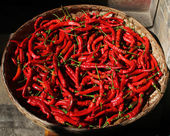 A basket full of fresh spicy chilli peppers in a Chinese market. — Stock Photo