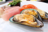 Mussel with sauce — Stock Photo
