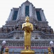 Stock Photo: Budha statue stand front of ancient big pagoda in Wat Arun