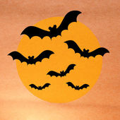 Halloween night with bat and full moon on grunge background — Stock Photo