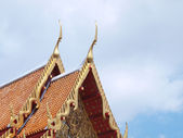 Thai temple roof top decoration in marble temple — Stock Photo