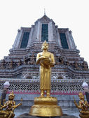 Budha statue stand front of ancient big pagoda in Wat Arun — Stock Photo