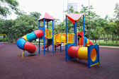 Playground without children in city park — Stock Photo