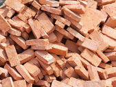 Group of bricks square construction materials — Stock Photo