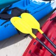 Yellow kayak oar on the red kayak — Stock Photo