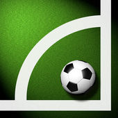 Football ( soccer ball ) in green grass — Stock Photo