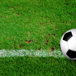 Soccer Ball on green grass field from top view — Stock Photo
