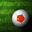 China Flag Pattern 3d rendering of a soccer ball in green grass — Stock Photo