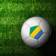 Gabon Flag Pattern 3d rendering of a soccer ball in green grass — Stock Photo
