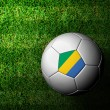 Gabon Flag Pattern 3d rendering of a soccer ball in green grass - Stock Photo