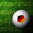 Germany Flag Pattern 3d rendering of soccer ball in green gras — Stockfoto #12242717