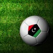 Libya Flag Pattern 3d rendering of a soccer ball in green grass — Stock Photo