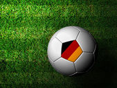 Germany Flag Pattern 3d rendering of a soccer ball in green gras — Stock Photo
