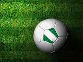 Nigeria Flag Pattern 3d rendering of a soccer ball in green gras — Stock Photo