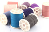 Threads in spools isolated in white background — Stock Photo