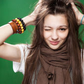 Winking teen-age girl — Stock Photo