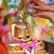 Showering the Buddha staue — Stock Photo