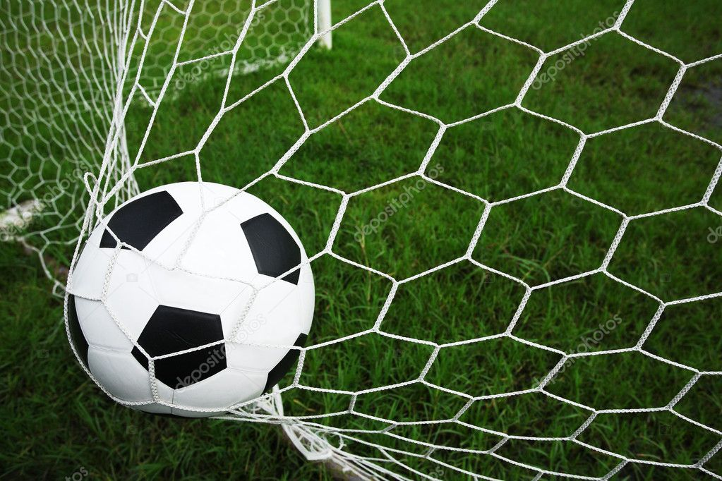 Soccer ball in goal — Stock Photo #12358523