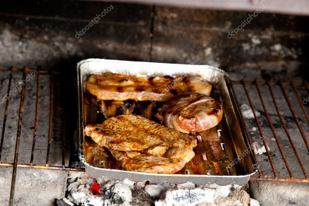 Various kind of meat on the grill — Stock Photo #11220492
