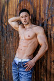 Dramatic fashion portrait of athletic fit male model — Stock Photo