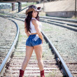Beautiful cowgirl near the railroad — Stock Photo #11556794