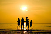 Funny family silhouette on the beach — Stock Photo
