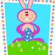 Easter bunny holding colorful egg. Easter card — Stock Vector