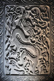 Dragon stone sculpture in wall, China — Stock Photo