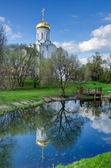 Church on the river side — Stock Photo
