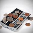 Stock Photo: Calculator and coins
