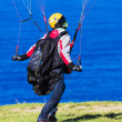 Mcontrolling parachute on windy day. — Stock Photo #11234119
