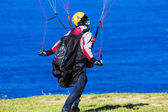 Man controlling parachute on windy day. — Stock Photo