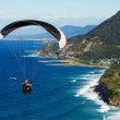 Parachuting over the ocean at Stanwell tops NSW Australia — Stock Photo